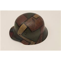 German WW I era helmet with period camo from  WW I or possibly WW II; no liner.                   Es