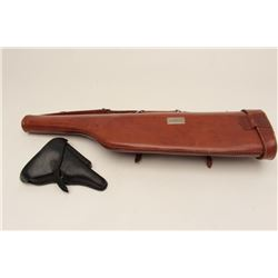 "Leather lot including a brown leather mutton  leg style shotgun carry case with plaque  marked ""R.M."