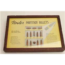 Nosler bullet board featuring Nosler  Partition bullets.  The board is in good  overall condition wi