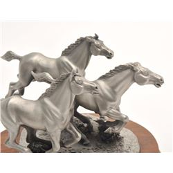 """Pewter sculpture by Brian Rodden and issued  by Chilmark Collectors Society entitled  """"Saving the Co"""