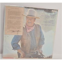 "John Wayne's ""America, Why I Love Her"" vinyl  record in sealed original dust cover.          Est.:"