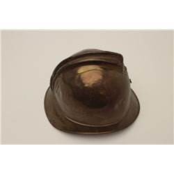 Brass Belgian Fireman's helmet; nice patina,  some scattered old denting.     Est.:   $50-100