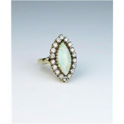 Exquisite Vintage ring featuring a MQ shaped  Australian Opal weighing approx. 4.00 carats  and surr