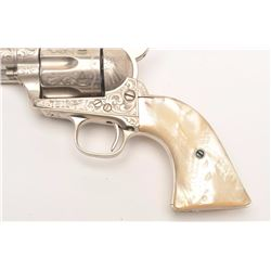 "Engraved Colt SAA revolver, .45 caliber,  4.75"" barrel, old re-nickel finish, two-piece  pearl grips"