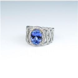 Gorgeous ladies ring set featuring a fine  Tanzanite weighing 3.25 carats and surrounded  by over 10
