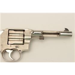 """Colt New Service cut-away revolver with a 5  ½"""" barrel in factory nickel.  A factory  cut-away displ"""