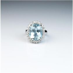 Exquisite Princess Diana design ring  featuring a fine Aquamarine weighing approx.  9.00 carats and