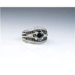 Classic ladies Platinum/14 karat white gold  ring featuring a center Black diamond  weighing over 1.