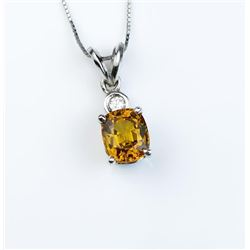 Very high quality ladies pendant set with an  extra fine Yellow/Orange sapphire weighing  2.20 carat