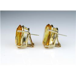 Amazing 'VANCLEEF and ARPEL' earrings  featuring two matching oval cut Citrines  weighing 38.85 cara