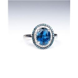 Stylish ring set with a London blue Topaz and  surrounded by 60 round white and blue  diamonds with