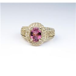 Colorful ring featuring a pink Tourmaline and  pave set with over 80 round diamonds  weighing approx