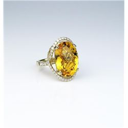 Spectacular ring featuring a checkerboard cut  Citrine weighing approx. 20.00 carats and  micro set