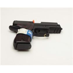 Sig Sauer P220 Elite in .45 caliber with  nitron finish, night sights, S/NG510107. Like  new in the