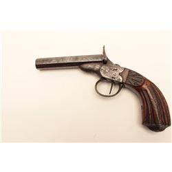 Antique rim fire single shot pistol,  approximately .35 caliber, Serial #NSNV.  The  pistol is in go