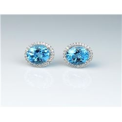 Dazzling ladies earrings featuring two  matching Swiss Blue Topaz weighing approx.  4.00 carats and