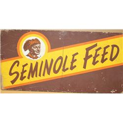 """Large fiberboard painted sign advertising  """"SEMINOLE FEED"""", approximately 24"""" x  48"""" in  overall goo"""