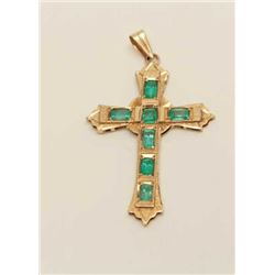 Custom Designer made 18k Gold Cross set with  7 Emeralds weighing over 4carats and of high  quality.