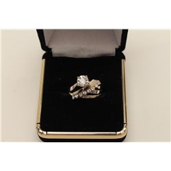 Approx. 1.03 ct Center Diamond estimated F-G  color and V-S clarity, mounted in 18k with 8  small si