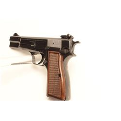 "Browning High Power semi-automatic pistol,  9mm caliber, 4.5"" barrel, blued finish,  checkered wood"