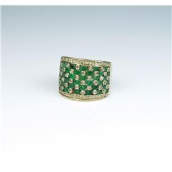 Incredible mosaic design ring featuring over  forty natural round fern green emeralds  weighing appr