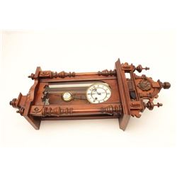 Germanic clock circa 19th century, two key  wind and chiming. Running with key.  Est.$250-500