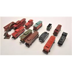 Lot of 12 old toy train cars, ca. 1930s-40s,  by Lionel and American Flyer with a railroad  crossing
