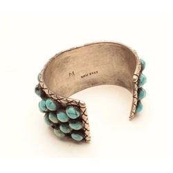 """Beautiful Thunderbird turquoise and coral  inlayed bracelet.  The bracelet band is  marked with an """""""