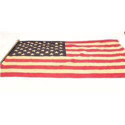 50 star American flag on pole; shows age.      Est.:  $75-$150.