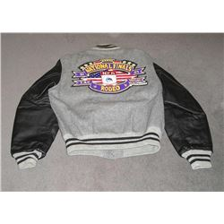 "Baseball style jacket with gray flannel body  with black leather sleeves. Back of jacket  reads ""XXX"