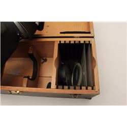 """Aviator's view finder with lenses in wood  container (container is approximately 9"""" x  20"""" x 8"""")."""