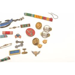 Lot of approximately 22 misc. U.S. military   pins, buttons, ribbons, etc. and a pair of   G.I. dog