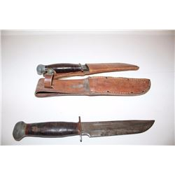 Lot of 2 PAL hunting knives, each with a  leather sheath.       Est.:  $50-100