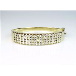 Amazing ladies Bangle Bracelet channel set  with sixty eight round diamonds with a total  weight of