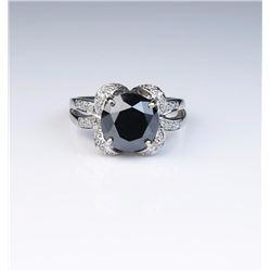 Exquisite ladies ring featuring a round Black  diamond weighing 3.11 carats and pave set  with 22 ro