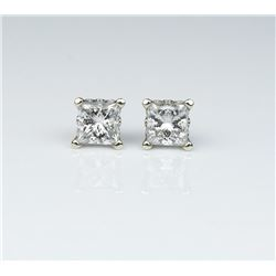 Spectacular ladies earrings featuring two  fine matching Princess cut diamonds weighing  1.42 carats