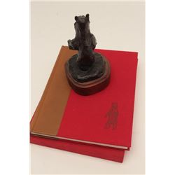 Bronze of bear (1972 dated) with book; Harold  Von Schmidt who draws and paints Old West;  priced at