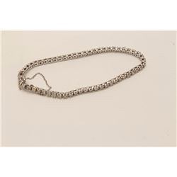 One tennis bracelet in 14 k white gold set  with approx 3ct of fine quality full cut  diamonds. EST.