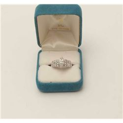 One ladies marquee diamond ring set with  rounds and baguettes side,in 14k white gold.  Center marqu