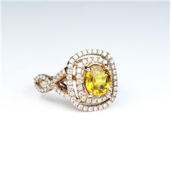 Gorgeous ring featuring a fine Orange  Sapphire weighing approx. 2.50 carats and  fine set with over
