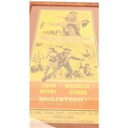 """Original two color lobby poster for John  Wayne movie """"McClintock""""; approximately  38.75"""" x 20.5""""."""