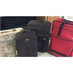 Suit cases (red one has set inside)