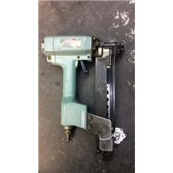 Pneumatic staple gun