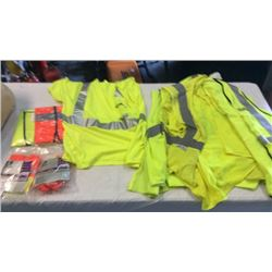 Lot of reflective safety vests, shirts, and hard