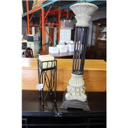 TWO POTTERY AND IRON CANDLESTANDS