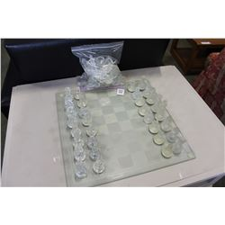 GLASS CHESS BOARD WITH 2 SETS OF PIECES