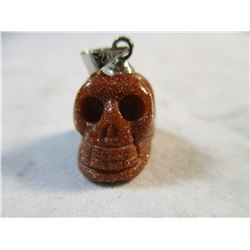 Carved Goldstone Skull Pendant