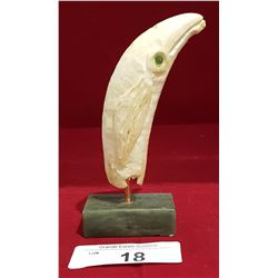 CARVED MARINE IVORY ON WHALE'S TOOTH ON SOAPSTONE STAND W/JADE EYES