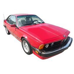 1987 BMW M6 Slant Coupe; Standard Transmission; Gasoline; Rear Wheel Drive; Sunroof; Red with White