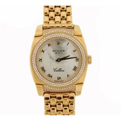 WATCH: Lady's 18ky Rolex Cellini Cestello diamond wristwatch; cushion case; white MOP dial with gold